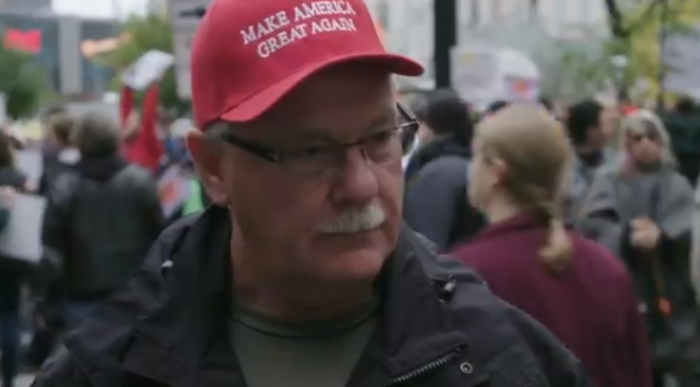 Watch What This SICK Anti-Trump Protester Does To A MAGA Man During His Interview